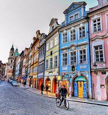 colorful prague notice the different architectural styles on the