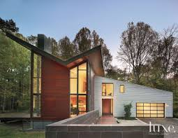 modern mahogany exterior with butterfly roof luxe interiors design