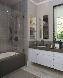 wonderful white vanity and grey top beside closed tub and shower