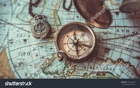 World Map Necklace by Antique Bronze Emblem Compass Mini Compass Stock Photo 541520356