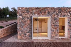 seaside single house a rebuilt stone barn in tuscany modostudio