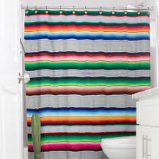 turn an old serape blanket into a new shower curtain add a pop of