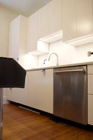 fitting ikea kitchen cabinets tips for installing ikea cabinet lighting the white