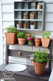 summer potting bench and kitchen garden stonegable