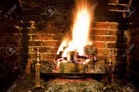 real roaring wood fire and open brick fireplace stock photo