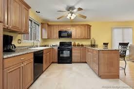 oak kitchen cabinets yellow walls flooring oak w yellow walls and mediumbrown