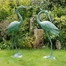 large metal heron garden sculpture garden sculptures candle and blue