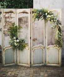 wedding backdrop vintage rustic backdrop filled with air plants and mixed greenery deer