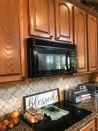should i paint or stain my oak kitchen cabinets tips and ideas how to update oak or wood cabinets paint