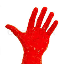 red paint a hand is covered with red paint stock photo colourbox