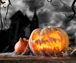 background of halloween concept of halloween pumpkin on wooden planks blur scary castle