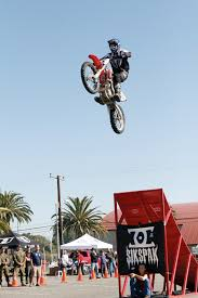 motocross freestyle tricks talented motocross riders show skills support at special event