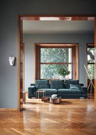 dark gray matte wall paint color bedroom with a dark hardwood