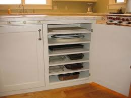 lower kitchen cabinet storage ideas add additional shelves in lower cabinets to store flat items