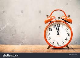 desk alarm clock old retro orange alarm clock on stock photo 669100669 shutterstock