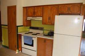 Refinishing Kitchen Cabinets Before And After by A Frame Kitchen Remodel Refaced The Cabinets By Adding Trim And