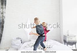 Fun In The Bedroom Little Boy Gray Pajamas Jumping On Stock Photo 588134492