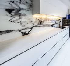 slick and futuristic kitchen design completehome