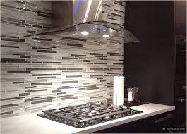 espresso brown dark kichen cabinets white countertop gray mosaic