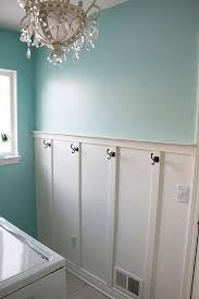 bathroom chair rail ideas a higher chair rail with hooks it for this laundry room idea