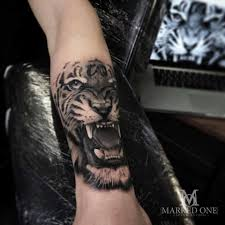 adam of marked one large tiger on forearm black and