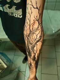 mystical designed black ink tree on sleeve pm