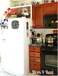 above the fridge decor kitchen essentials clutter and trays at