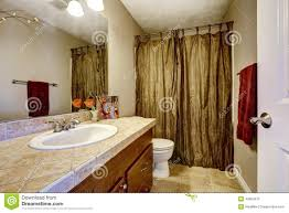 Mustard Curtain Bathroom With Brown Cabinet And Mustard Curtains Stock Photo