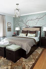 grey bedroom wall with floral paint combined by dark brown wooden
