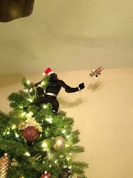 king kong tree topper with santa in a plane yesss merry