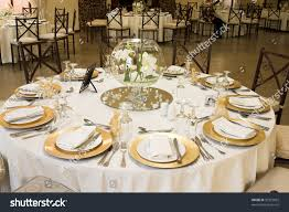 table setting pictures wedding table setting golden coloured plates stock photo 30325855