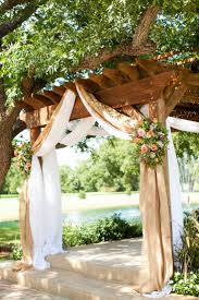 wedding arch gazebo burlap draping with country pink and green flowers wooden rustic