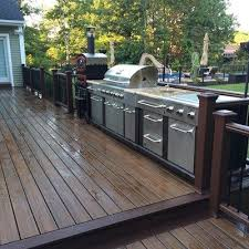 this backyard project includes a multilevel trex deck with cooking