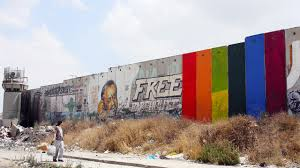 palestinian artist s rainbow mural on the west bank wall has khaled jarrar s rainbow mural through the spectrum painted on the israeli separation wall near