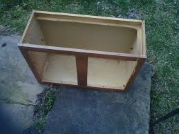 my homemade brooder made from an old kitchen cabinet backyard