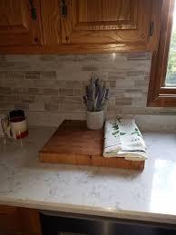 what color quartz with oak cabinets oak cabinets with lyra quartz and marble backsplash