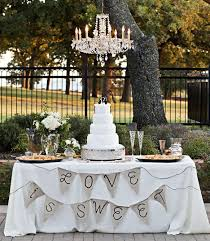 wedding cake table is sweet wedding bunting flags banners