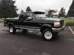 lifted black ford f150 1994 ford f 150 xlt 4x4 extended cab 2 door 5 8l 4inch lift