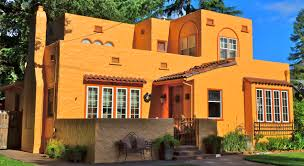 adobe style home mission revival style with an adobe style stucco exterior and tile