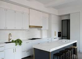 flat white wood kitchen cabinets gold and blue island with white flat front cabinets modern