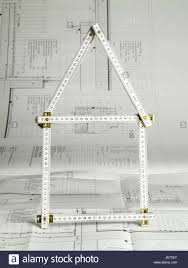 planning to build a house architect s plan yard stick folded contours house icon