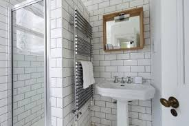bathroom flooring white subway tile charcoal grout dark bathroom