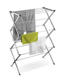 nice white concrete wall can be decor with laundry drying rack can nice white nuance of the laundry drying rack that can be decor with iron materials can