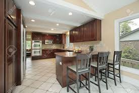 kitchen in suburban home with breakfast bar stock photo picture