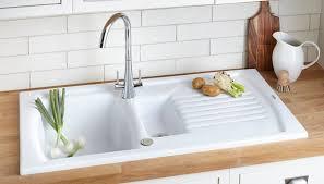 white subway tile backsplash double handle kitchen faucets dark