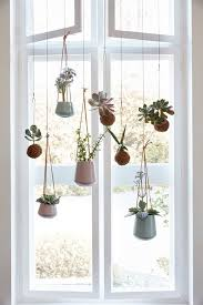 How To Hang Curtains On A Round Top Window Best 25 Window Hanging Ideas On Pinterest Plant Window Shelf