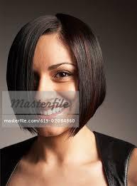 hairstyles for hispanic women over 50 hispanic woman with bob hairstyle stock photo masterfile