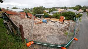 wollongong council to review rules on asbestos lead and dust