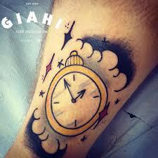 simple clock tattoo on leg by elda bernardes clock in