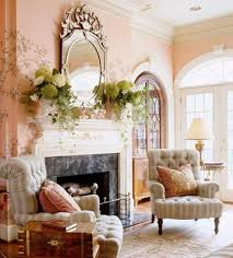 fireplace mantel with flower vases and venetian mirror elegant